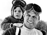 Ted Kennedy Gives His Nephew John F Kennedy Jr a Piggy-Back Ride Down Ski Slopes in Stowe  Vermont