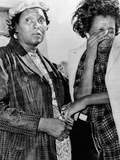 Two African American Women Stand Outside Hospital  Mourning Pres John Kennedy's Death  Nov 22  1963