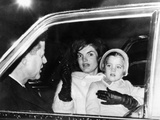 President John and Jacqueline Kennedy in a Limousine with their Four Year Old Daughter Caroline