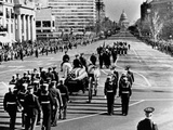 President Kennedy'S Flag-Draped Coffin Moves Slowly Past Mourning Crowds