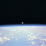 Moon Set and Earth Horizon Taken from Space Shuttle Discovery  July 14  1995