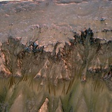 Mars Landscape Showing Flows That Appear in Spring and Summer on a Slope Inside Mars&#39; Newton Crater
