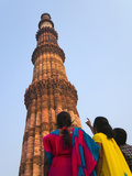 Indian Women Watching Qutb Minar and its Monuments (UNESCO World Heritage Site)  Delhi  India