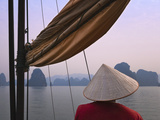 Girl with Conical Hat on a Junk Boat and Karst Islands in Halong Bay  Vietnam