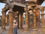 Tourist Photographing Qutb Minar (UNESCO World Heritage Site)  Delhi  India