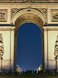 People Standing under the Arc De Triomphe at Night  Paris  France