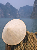 Conical Hat on Junk Boat and Karst Islands in Halong Bay  Vietnam
