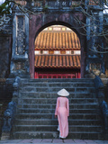 Girl in Ao Dai (Traditional Vietnamese Long Dress) and Conical Hat at Minh Mang Tomb  Vietnam