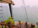 Junk Boat and Karst Islands in Halong Bay  Vietnam