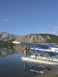 Fisherman and Floatplane  Takahula Lake  Alaska  USA