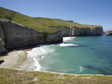Tourists on Beach and Cliffs at Tunnel Beach  Dunedin  South Island  New Zealand