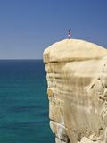 Tourist on Cliff Top at Tunnel Beach  Dunedin  South Island  New Zealand