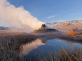 Fly Geyser with Snow Capped Granite Range in the Black Rock Desert Near Gerlach  Nevada  USA