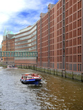 Boats Pass by Waterfront Warehouses and Lofts  Speicherstadt Warehouse District  Hamburg  Germany