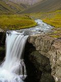 Water Running from Glacier and Waterfall  Iceland