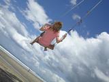Young Girl on Rope Swing under Pohutukawa Tree  Waihi Beach  Coromandel  North Island  New Zealand
