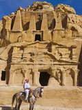 Man Riding on Horse with the Tomb of Obelisks  Petra  Jordan