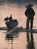 Fisherman Fishing with Cormorants on Bamboo Raft on Li River at Dusk  Yangshuo  Guangxi  China