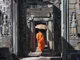 Monk with Buddhist Statues in Banteay Kdei  Cambodia