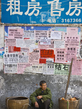 Man by Wall with Posters  Guilin  Guangxi  China
