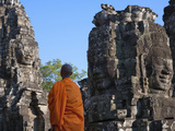 Monk with Huge Smiling Face at Bayon Temple  Angkor Thom  Cambodia