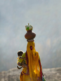 Village Woman Carrying Baby and Load on the Head  Udaipur  Rajasthan  India
