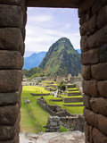 View Through Window of Ancient Lost City of Inca  Machu Picchu  Peru  South America with Llamas
