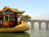 The Summer Palace  Traditional Dragon Boat and Seventeen Arch Bridge  Kunming Lake  Beijing  China