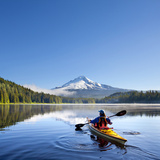 A Woman in a Sea Kayak Paddles on Trillium Lake  Oregon  USA