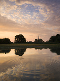 Salisbury Cathedral Spire and Beautiful Dawn Sky Reflected in Rippled Pond  Salisbury  England