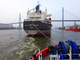 Tugboat and Freighter in Harbour  Hamburg Seaport  Germany  Europe