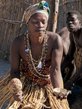 Local Woman Dancing with Gourd Rattle  Kxoe Village  Kwando River Area  Eastern Namibia