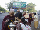 Monks Gathering Alms in the Streets of Yangon  Myanmar (Burma)  Asia
