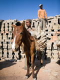Donkey Getting Unloaded by Young Male Nepali Worker in Outdoor Brick Kiln  Kathmandu  Nepal