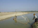 Youngster Fishing with Fishing Net in a Waterway  Irrawaddy Delta  Myanmar (Burma)  Asia
