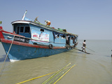 Passenger Disembarking from a Public Boat at Lay Win Kwin Village  Irrawaddy Delta  Myanmar (Burma)