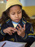 Female Young Rescued Nepali Child Doing Sums in Orphanage  Bhairawa  Nepal