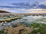 Sunset over Rocks and Pools at Dunraven Bay  Southerndown  Wales