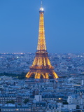 Illuminated Eiffel Tower  Viewed over Rooftops  Paris  France  Europe