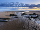 Sunset over Rocks with Flowing Water at Dunraven Bay  Southerndown  Wales