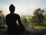 Stone Buddha Silhouetted at Sunrise  Borobudur Temple  UNESCO World Heritage Site  Java  Indonesia