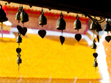 Close Up of Prayer Bells Silhouetted Against Colourful Roof at Wat Doi Suthep  Chiang Mai  Thailand
