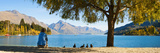 Panorama of Tourist Relaxing by Lake Wakatipu in Autumn at Queenstown  Otago  New Zealand