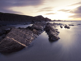 Long Exposure of Waves Moving over Rocks on Crackington Haven Beach at Sunset  Cornwall  England