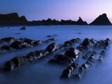 Waves Moving over Jagged Rocks at Dusk  on Hartland Quay Beach  Cornwall  England  UK  Europe