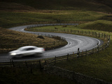 Silver Sports Car Driving Through Winding Road in Peak District National Park  Derbyshire  England