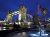 Girl with Dolphin by David Wynne  Illuminated at Night in Front of Tower Bridge  London  England