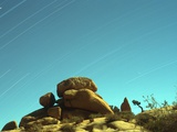 Time Exposure of Stars across Sky with Rock Formations  Joshua Tree Nat'l Park  California  USA