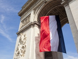 French Flag under Arc de Triomphe Built by Napoleon  Paris  France  Europe