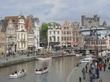 Everyday Scene Along Graslei Bank  Gravensteen Castle Beyond  in Centre of Ghent  Belgium